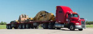 A Big Red Colored Gradewine's Truck Handling the Logistics