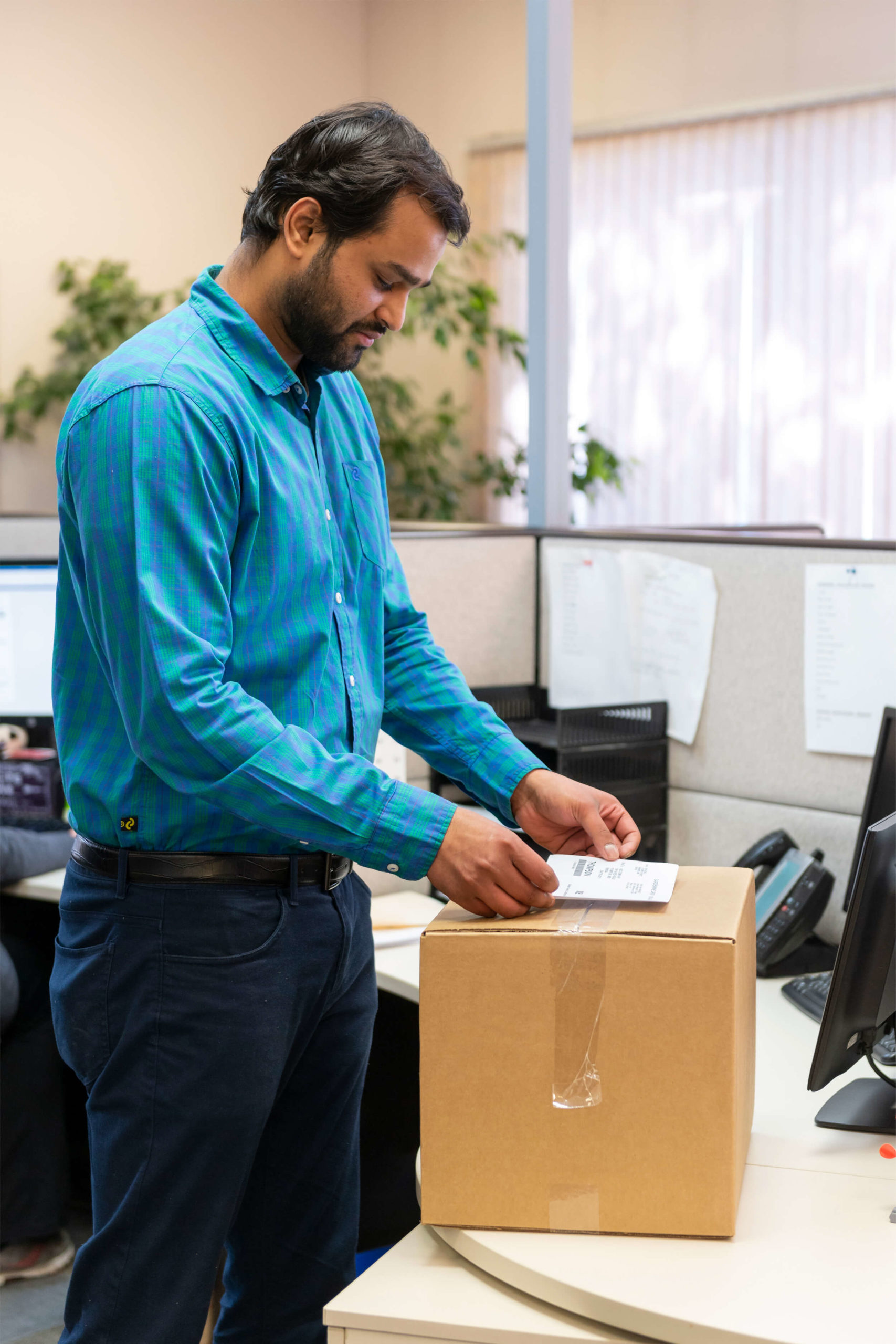 A Man is Pasting Bar Code for Shipping Tracking